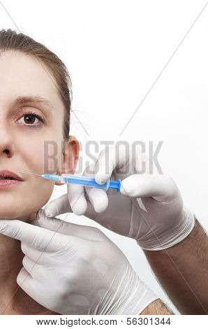 Woman getting injection to remove wrinkles