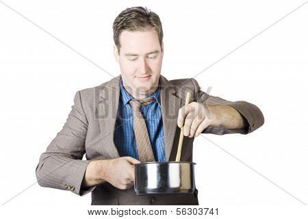Cooking Man Stirring Food With Wooden Spoon