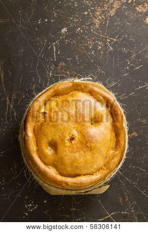 Melton Mowbray Pork Pie On Distressed Metal