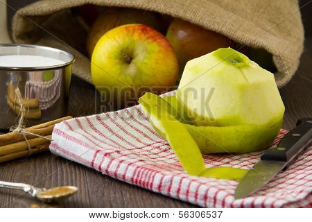 Peeled Apple With Ingredients For An Apple Pie
