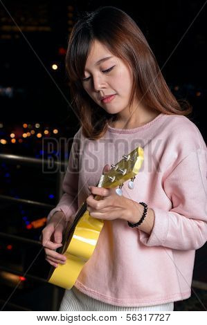 Pretty Asian Woman With Ukelele