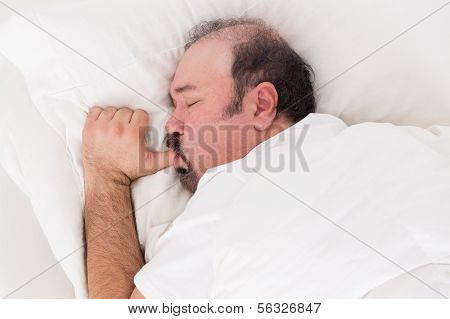 Man Sucking His Thumb While Sleeping
