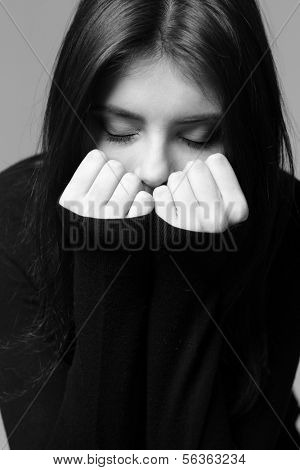 Black and white closeup portrait of a nervous woman