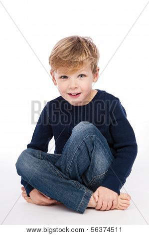 Cute Boy Sitting Cross Legged.