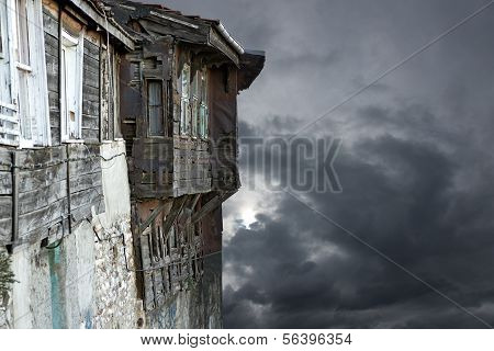 Old building on Gray Moody Sky
