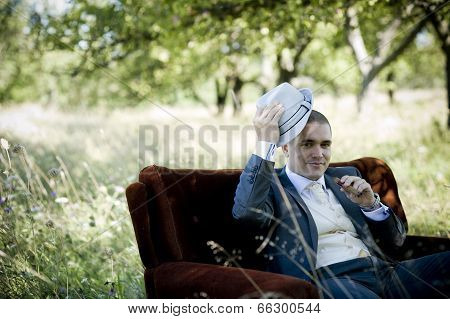 Handsome groom with cigarette