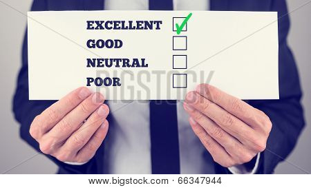 Man Holding A Survey Check With Check Boxes