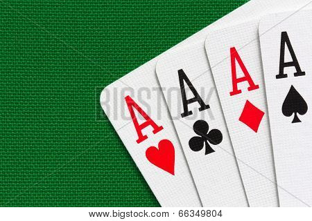 Four Aces Over Green Textile Background