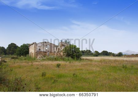 Derelict abandoned farmhouse in countryside