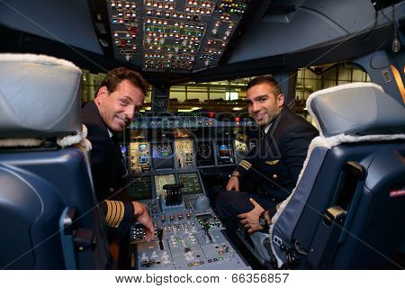 HONG KONG, CHINA - MAY 16, 2014: pilots in Emirates Airbus A380 aircraft after landing MAY 16, 2014. Emirates is the largest airline in the Middle East