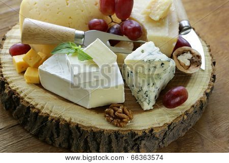 cheeseboard with assorted cheeses (parmesan, brie, blue, cheddar)