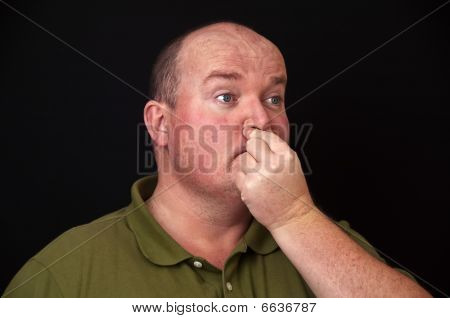 Overweight Male With A Sore Nose Sinus Issue