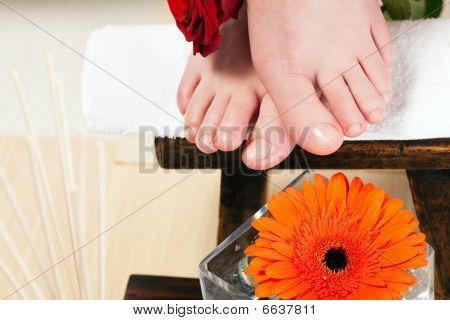 Feet on a stool