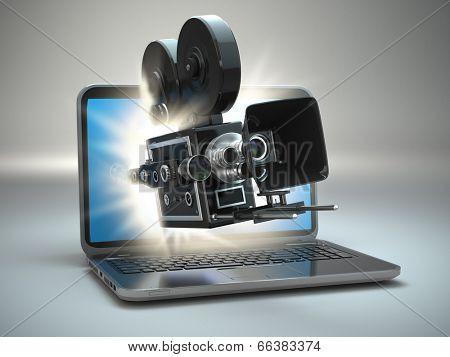 Video concept. Retro camera and  laptop. 3d