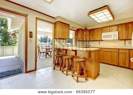 Rustic Kitchen Room With Walkout Deck