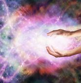 Healer's hands outstretched into magical healing energy field poster