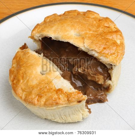 Individual steak meat pie cut open.