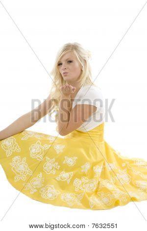 Girl In Yellow Dress Blowing Kiss