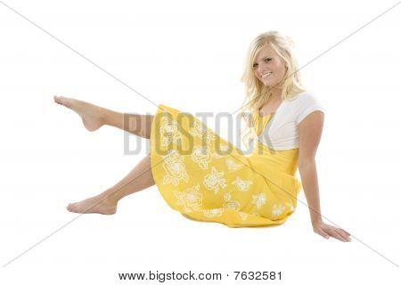 Girl In Yellow Sitting Leg Up