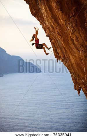 Female rock climber falling of a cliff