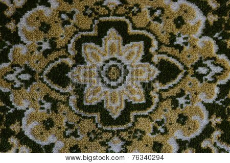 Whirly ornament on a carpet