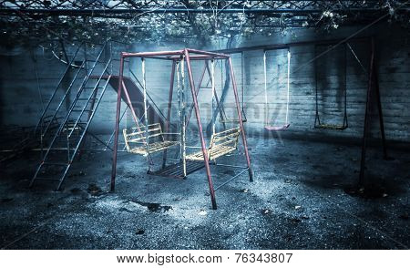 Old rusted playground, abandoned aged swings, destroyed childhood, damages in attraction park, war and poverty concept