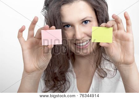 Girl's Hands With Two Slips Of Paper
