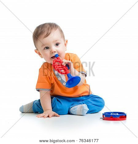kid playing  with musical toy isolated