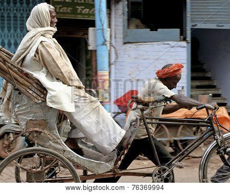 A rickshaw being pulled in Varanassi, India