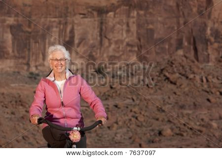 Senior Woman Riding A Bile