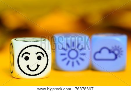 Concept Of Autumn Weather - Emoticon And Weather Dice On Orange Blackground