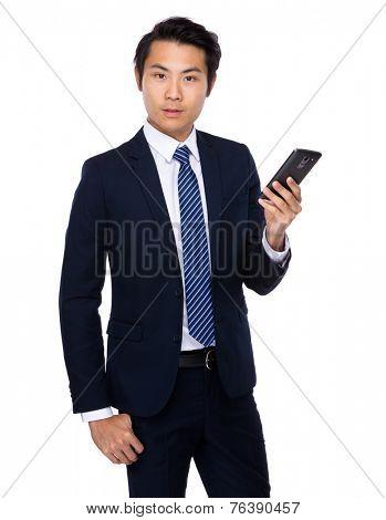 Buisnessman look at mobile phone