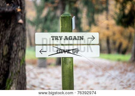 Signboard With Two Signs Saying - Try Again - Give Up - Pointing In Opposite Directions
