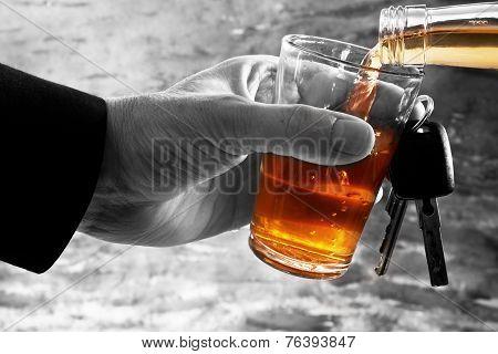 Man Behind Car Key And Glass