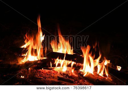 campfire in fireplace at a night