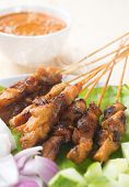 Chicken sate or satay, skewered and grilled meat, served with peanut sauce. Fresh cooked with steamed and smoke. Delicious hot and spicy Asian dish.  poster
