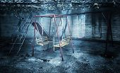 Old rusted playground, abandoned aged swings, destroyed childhood, damages in attraction park, war and poverty concept poster