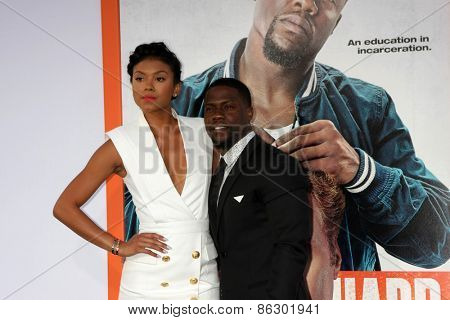 LOS ANGELES - MAR 25:  Eniko Parrish, Kevin Hart at the