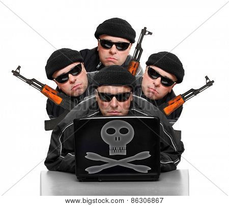 Group of terrorists with laptop and weapons.