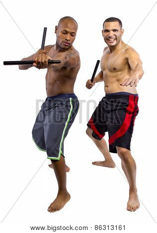 Martial Arts instructor teaching a student the Filipino Martial Art Kali Escrima or Arnis with fighting sticks. poster
