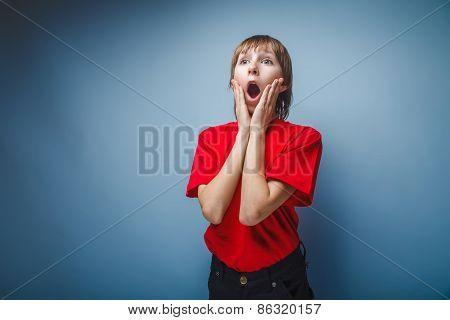 teenager boy in red T-shirt European appearance brown hair opene