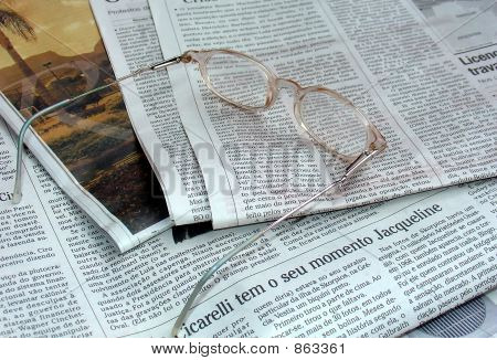Newspaper and the glasses