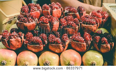 Ripe Cracked Raw Pomegranates On Side Streed Food
