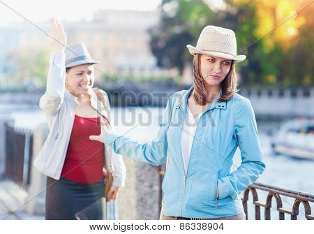 Young Beautiful Woman Having Quarrel With Her Friend In The City
