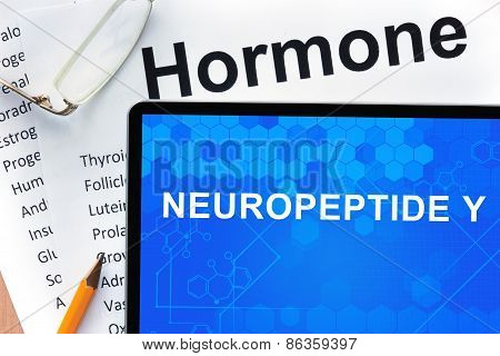 Papers with hormones list and tablet  with words neuropeptide Y.