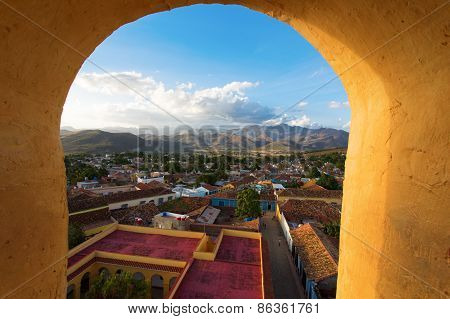 View of Trinidad Cuba from upwith blue sky and white clouds poster