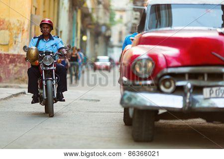 Havana - February 25: Unkown Police Man On Bike And Old Classic Car On February 25, 2015 In Havana.