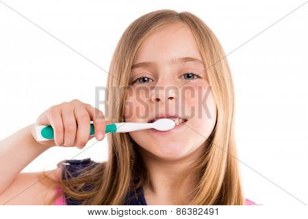 Blond kid indented girl cleaning teeth toothbrush on white background