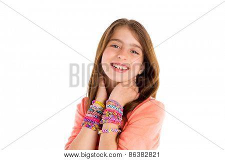 Loom rubber bands bracelets blond kid girl smiling hands in neck on white background