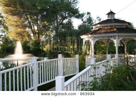 Gazebo with waterfall in a garden